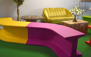 Yellow bench seat plastic curved modular for hire UK events parties