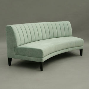 Luxury curved hire sofa for events in soft green UK