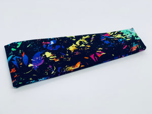 Rainbow Splatter on Black Headband-Turban Twist and Yoga Styles | Sweet Stitch Novelties