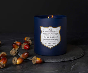 Manly Indulgence Dark Forest Candle lifestyle photo with acorns