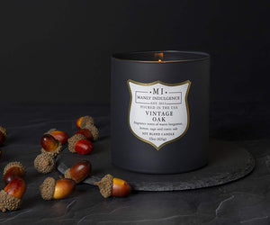 Manly Indulgence Vintage Oak Grey Large 15oz Jar Luxury Candle by Colonial Candle lifetyle shot with acorns