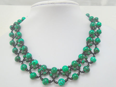 green gemstone and black seed bead necklace