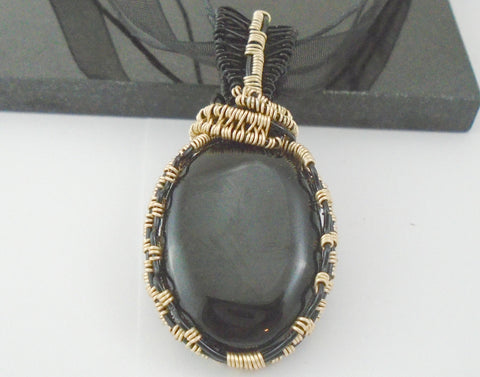 black and gold wire wrapped onyx pendant