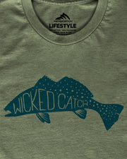 Fang Tooth Seatrout T-Shirt - Seagrass:  Wicked Catch lifestyle fishing t-shirt - folded closeup