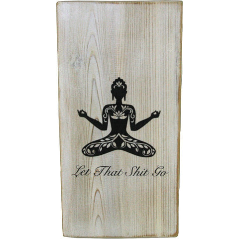 Rustic white wood sign with a black and white woman with flower pattern doing yoga