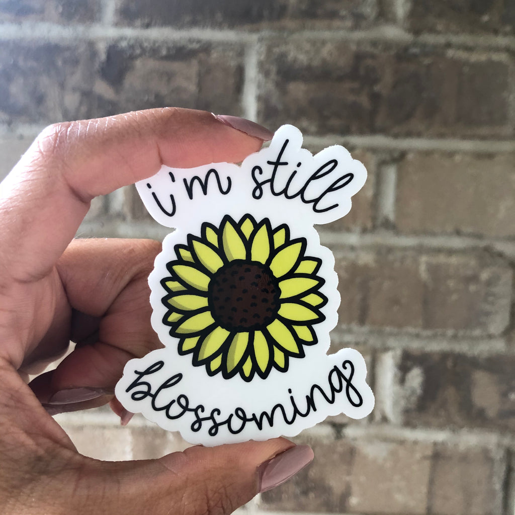 I'm Still Blossoming Sticker by EMEJOTA