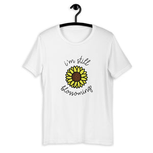 I'm Still Blossoming Short-Sleeve Unisex T-Shirt by EMEJOTA