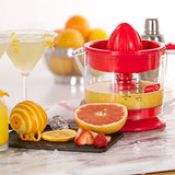 Dash Citrus Juicer Extractor: Compact Juicer for Healthy Juice, Oranges, Lemons, Limes, Grapefruit & other Citrus Fruit with Easy Pour Spout + 32 oz Pitcher - Red