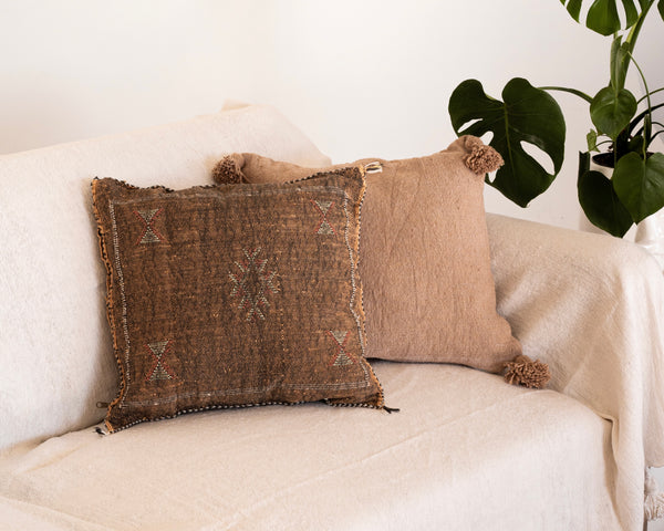 brown cactus silk pillow and beige moroccan vintage pillow