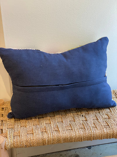 blue back of vintage cushion