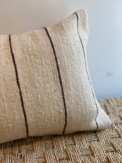 beige rectangle cushion with stripes