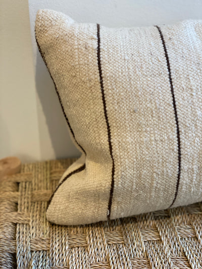 moroccan beige vintage cushion with dark thin stripes