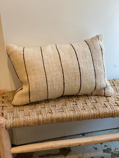 beige pillow with thin brown stripes
