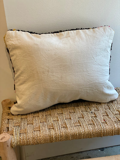 white back of moroccan boucherouite pillow