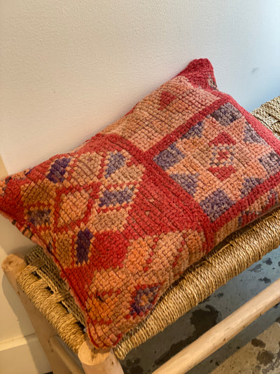 red cushion with tribal design