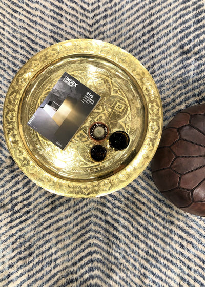 Beni ourain rugs morocco brass table leather pouf montreal the boho lab