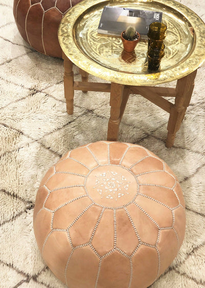 tan leather pouf with a soft Beni rug from morocco