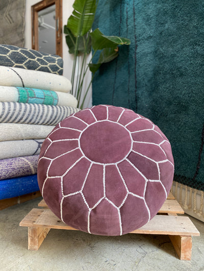moroccan suede circle ottoman, with oriental stitching design, purple colour. bohemian hygge and arabic interior style.