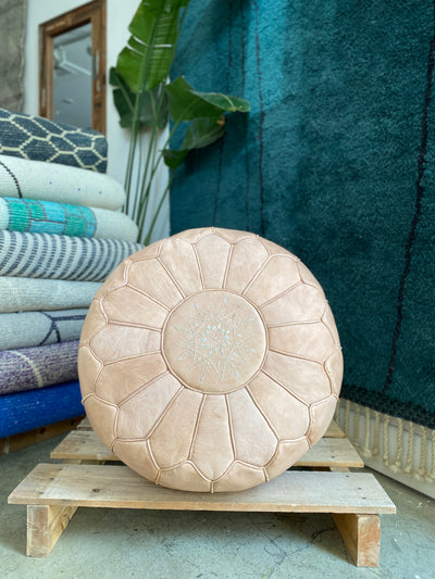 moroccan leather circle ottoman, with oriental stitching design, cream nude colour. bohemian hygge and arabic interior style.