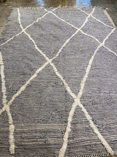 large gray moroccan kilim rug with white wool diamond patterns and white tassels