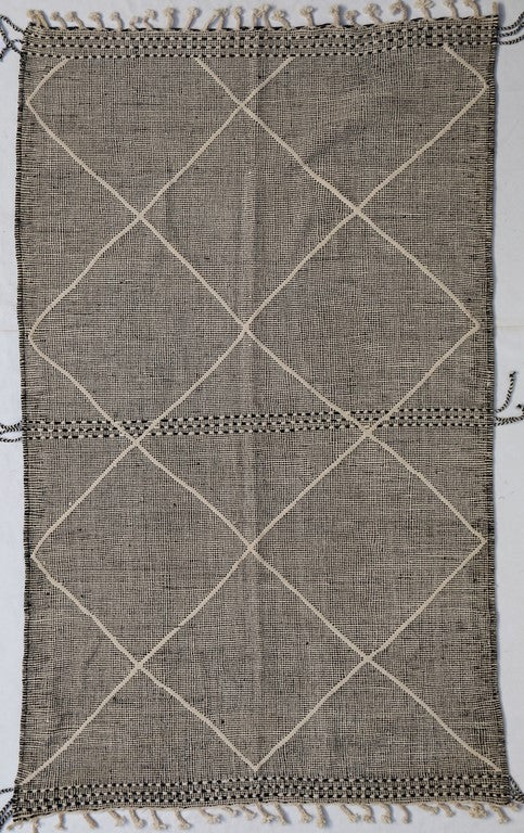 moroccan kilim rug with white diamond shapes
