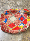 colorful vintage moroccan floor pillow with geometric design