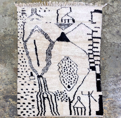area wool soft rug off white colour with tassels and black tribal ethnic design