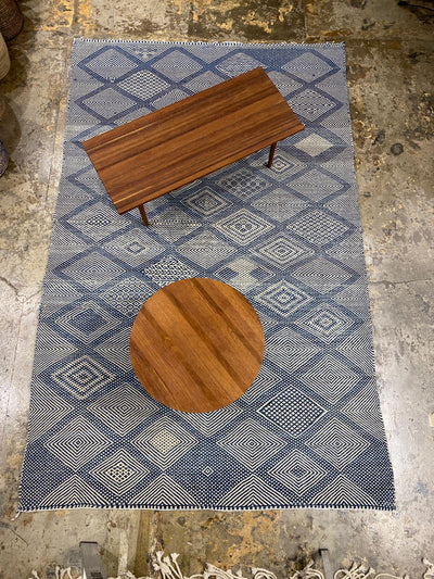 blue kilim large area carpet with tables on top