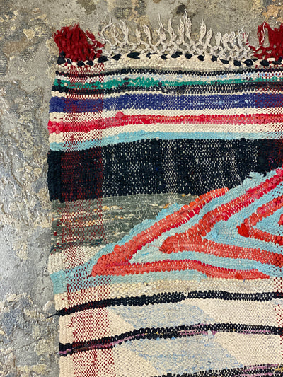 corner of moroccan no pile rug with abstract design
