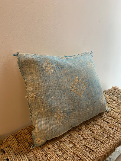 square blue decorative cushion