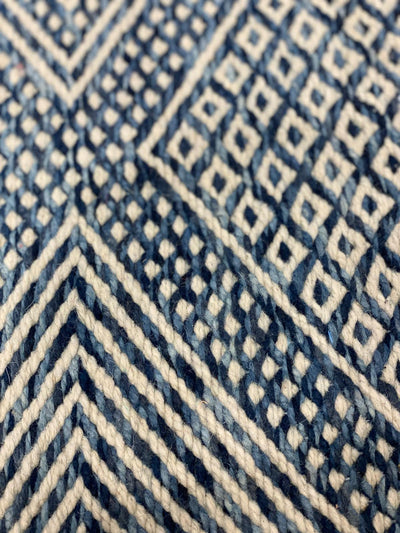 close up on the blue andx white wool on kilim rug
