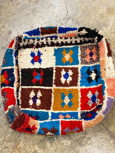 square moroccan floor pillow with colorful designs