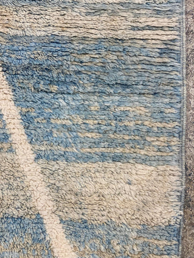 blue beige moroccan rug with abstract design