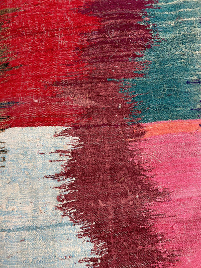 close up on colorful stripes bocuherouite rug