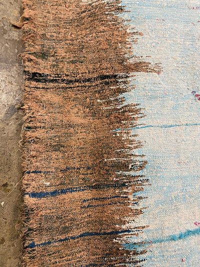brown end of colorful boucherouite rug