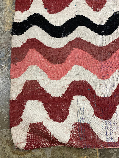 corner of boucherouite rug with colorful wave design