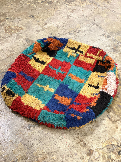 moroccan floor pillow with colorful design