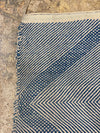 blue wool rug with geometrical shapes