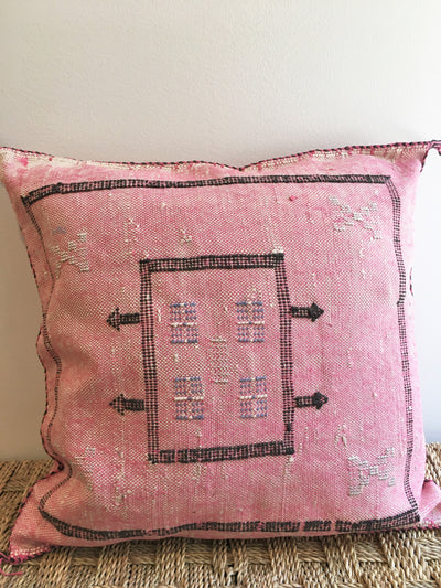pink square moroccan pillow with black design