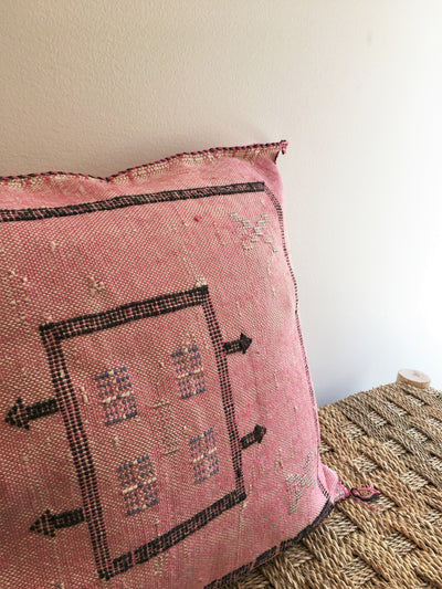 square pink bohemian pillow with black outlines