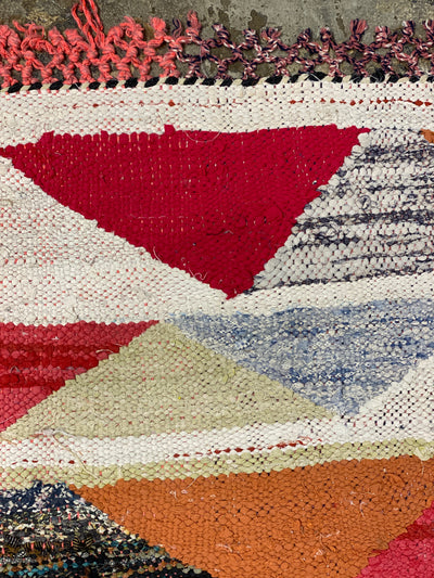 vintage boucherouite area rug with colored tassels