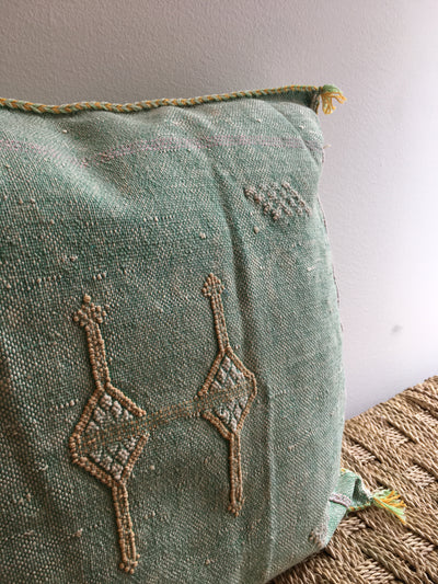 green sabra pillow cover with yellow design
