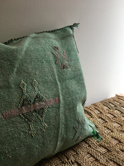 green sabra cushion with green and pink detailing