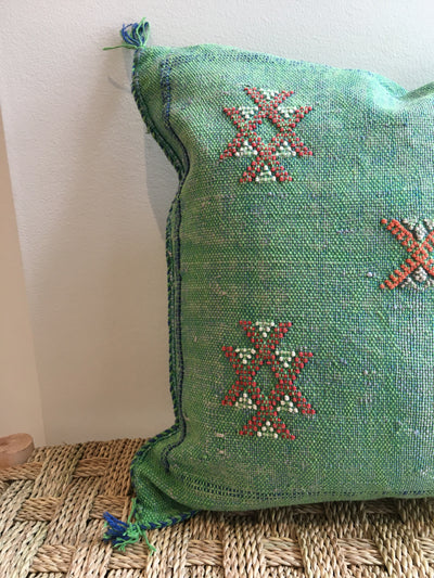 green cactus silk cushion with red details