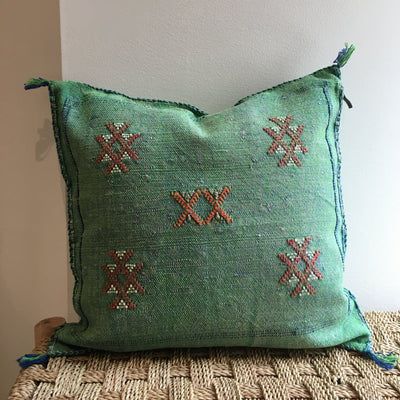 square green sabra silk pillow with red designs