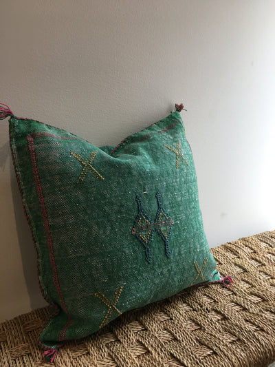 green cactus silk cushion with pink, blue and yellow tribal design