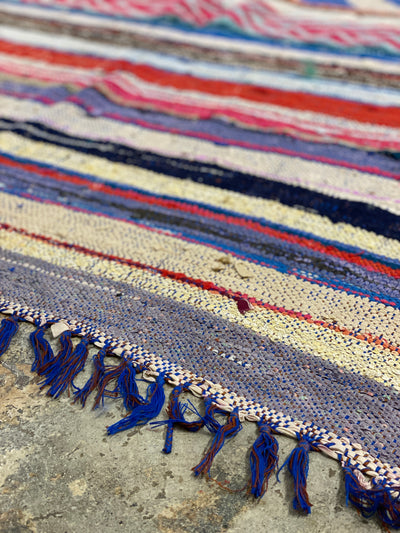 blue tassel carpet with colorful stripes