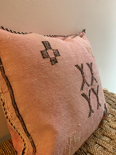 pink and brown pillow