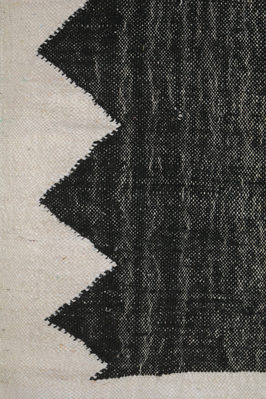 black no pile kilim carpet with beige outline