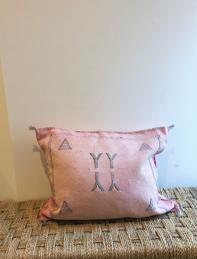 moroccan pastel pink cushion with blue design